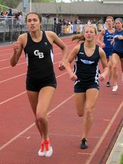 Grand Blanc's Gabrielle Anzalone (left) battles with