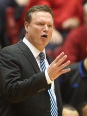 Kansas Head Coach Bill Self calls a play during their