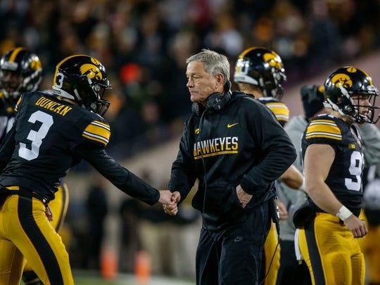 Iowa head football coach Kirk Ferentz celebrates a