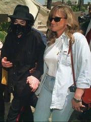 Pop singer Michael Jackson is shown with Debbie Rowe