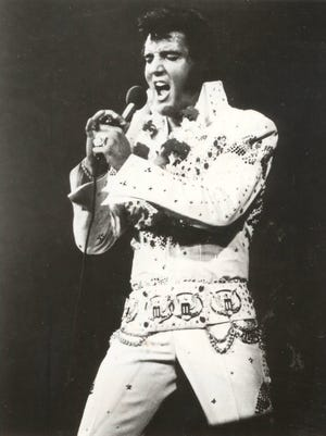 """Elvis Presley wore the same American eagle jumpsuit, shown in his famed """"Aloha from Hawaii"""" concert, at his 1973 show at Cincinnati Gardens."""