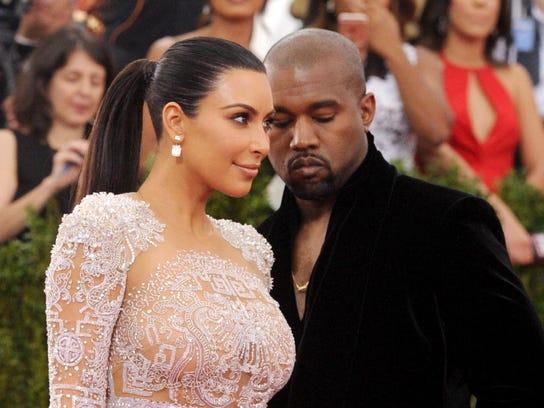 Kim Kardashian and Kanye West arrive at The Metropolitan