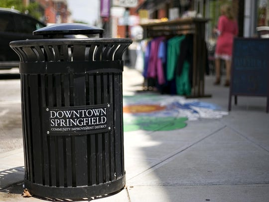 Trash cans placed throughout downtown are maintained using funds collected by the Downtown Springfield Community Improvement District. Springfield, Mo. on June 23, 2015.