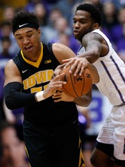 Iowa forward Cordell Pemsl (left) battles for a loose