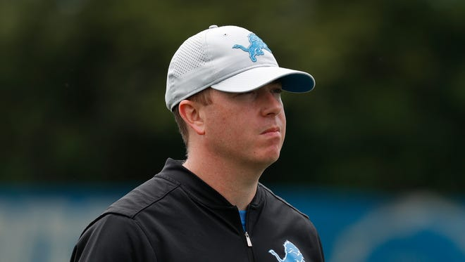 Detroit Lions general manager Bob Quinn watches practice at training camp in Allen Park, June 5, 2018.