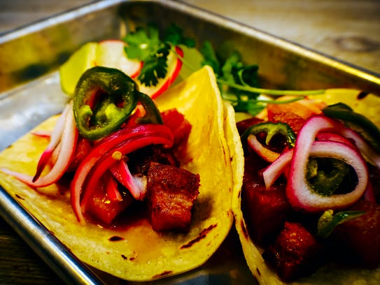 Pork Belly Tacos with pickled onion and jalapeno at