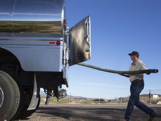Damon Bruns of Dynamite Water fills his truck on Sept.