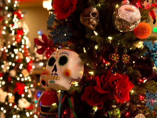 A tree with a Day of the Dead theme is displayed on Tuesday at the Festival of Trees at the Farmington Civic Center.