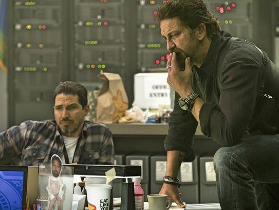"Maurice Compte (left) and Gerard Butler star in ""Den"