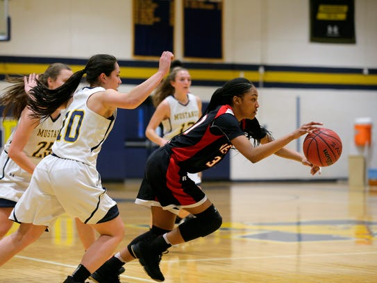Neptune's Makayla Andrews dribbles around Marlboro's