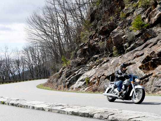 A motorcyclist takes a curve on the Blue Ridge Parkway