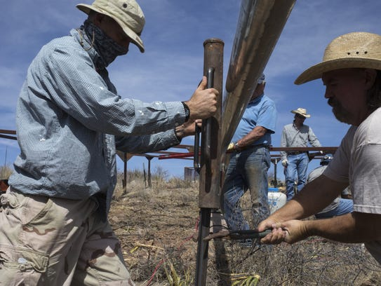 Texas Bighorn Society members work on a water guzzler