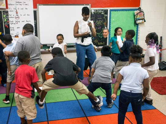 Students get up to sing and dance in the classroom