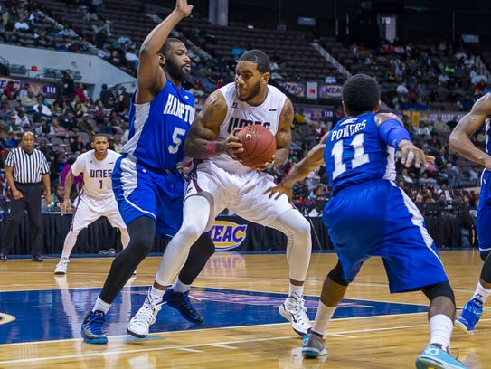 UMES's Mike Myers tries to make a move against two