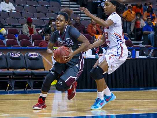 UMES' Jessica Long drives the lane during the MEAC