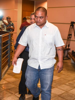Former corrections officer Fermin Maratita, foreground, exits the courtroom with his attorney, Douglas Moylan, after a change of plea hearing before Superior Court of Guam Judge Vernon Perez at the Guam Judicial Center in Hagåtña on Friday, Nov. 17, 2017.