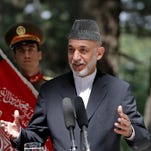 Afghan President Hamid Karzai speaks during a joint press conference with Italian Prime Minister Enrico Letta, unseen, at the presidential palace in Kabul on Sunday.