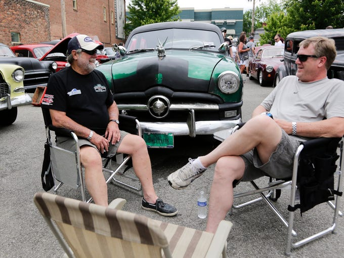 Jim J. Key, left, and Jim P. Key talk while at  the Beatersville Car and Bike Show at the Phoenix Hill Tavern.  Their 6c7 Chevy truck is in the background. May 25, 2014