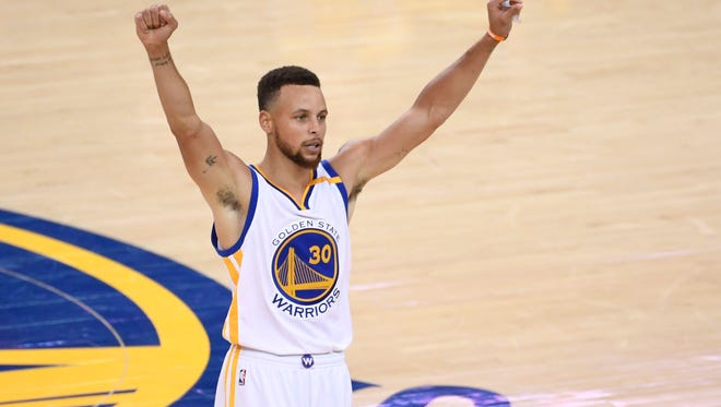 Golden State Warriors guard Stephen Curry (30) celebrates after defeating the Cleveland Cavaliers in game five of the 2017 NBA Finals at Oracle Arena.