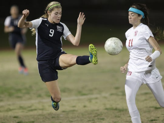 At left, La Quinta High School Kailee Prescott tries to control a pass against Palm Desert High School's Jane Jordan at Palm Desert on February 11, 2016. La Quinta won the game 3-1 for the DVL title.