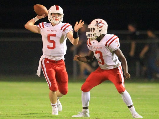Palmetto's Shaw Crocker (5) passes near teammate Daron Williford (3) during the second quarter at Crescent High School in Iva.