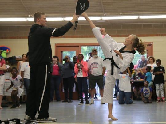 Natalie Hershberger, 13, demonstates a high kick during