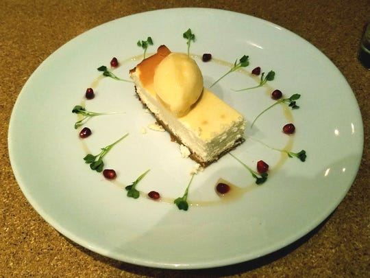 South Fork Kitchen and Bar's goat cheese cheesecake with a tart pomegranate puree and mango sorbet.