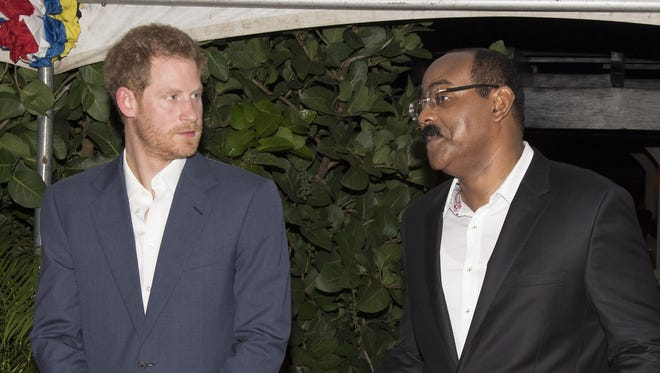 Prince Harry (left) with the Prime Minister of Antigua and Barbuda, Gaston Browne.