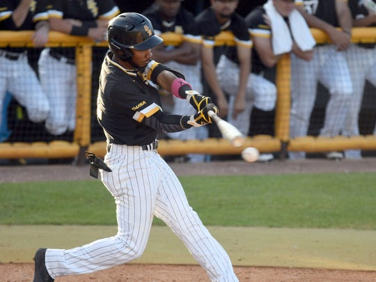 Southern Miss' LeeMarcus Boyd swings for the ball during a game against South Alabama at Pete Taylor Park on Tuesday, April 24, 2018.