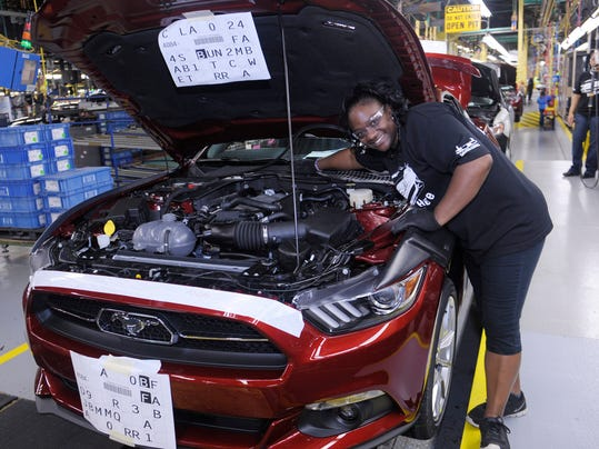 Latrice Young inspects a 2015 Mustang GT at Ford's Flat Rock Assembly Plant on August 28, 2014.(Photo: Detroit News file)