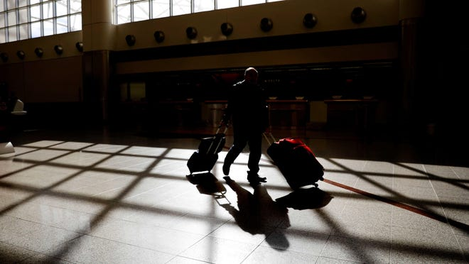 A traveler wheels his luggage through Atlanta's Hartsfield-Jackson International Airport, which handled more passengers in 2020 than any other U.S. airport despite the coronavirus pandemic.