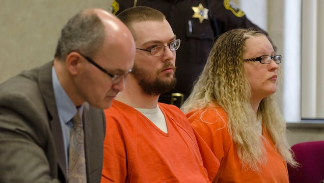 Andrew and Hilery Maison watch Thursday, March 10 as Judge Daniel Kelly sentences them to life in prison without parole for the murder of the 5-year-old Port Huron girl.