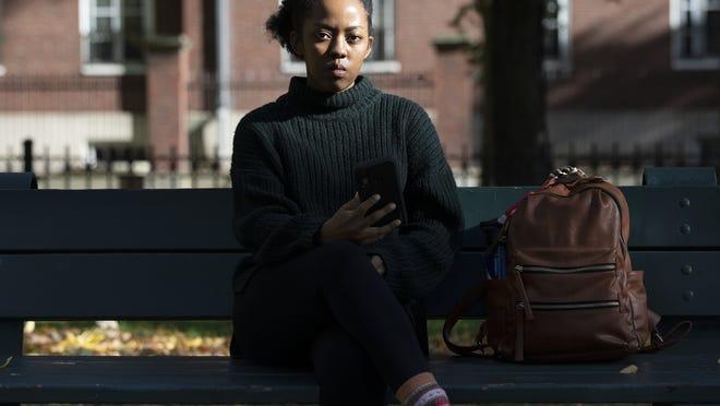 Harvard University graduate student Maya James poses in a park near the university Wednesday in Cambridge.
