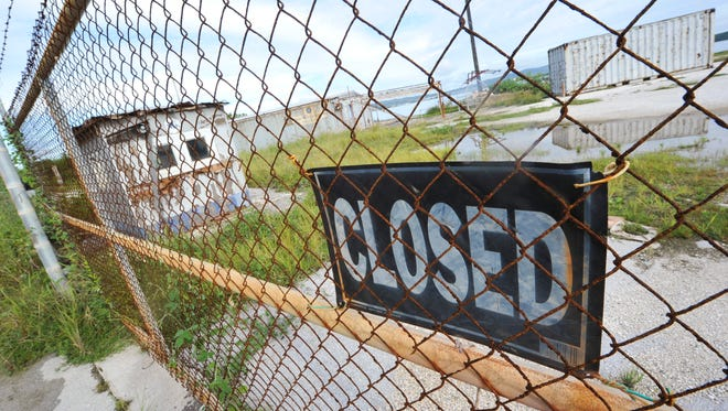A closed sign is posted at a locked gate of the Guam YTK Corporation Marine Products compound at the Hotel Wharf on Cabras Island as photographed on July 30, 2011.