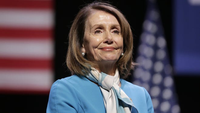 House Speaker Nancy Pelosi smiles while attending a bill signing ceremony in New York, Monday, Feb. 25, 2019.
