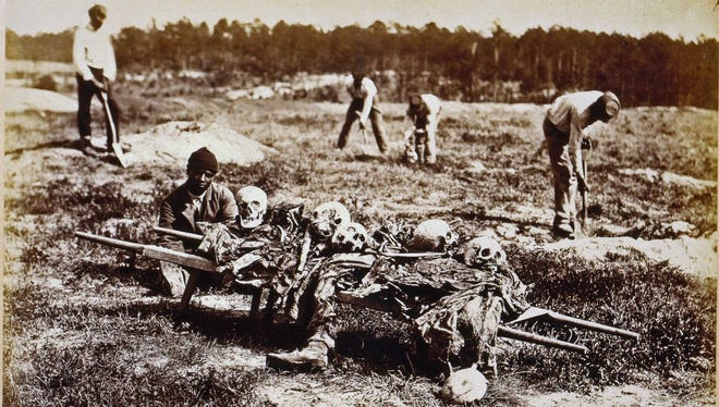A burial party works in the aftermath of the Battle of Cold Harbor in Virginia.