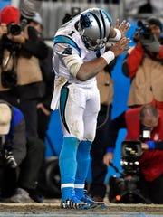 Carolina Panthers quarterback Cam Newton celebrates after scoring a touchdown in the NFC title game.