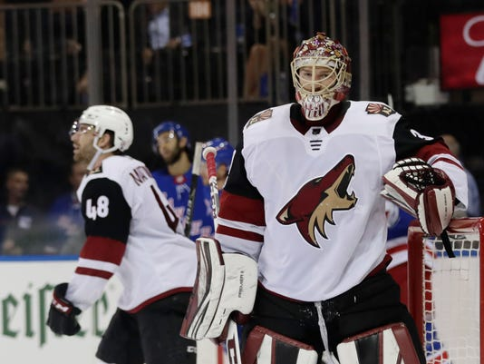 Arizona Coyotes goalie Adin Hill (31) and Jordan Martinook (48) react after New York Rangers' Michael Grabner scored a goal during the second period of an NHL hockey game Thursday, Oct. 26, 2017, in New York. (AP Photo/Frank Franklin II)