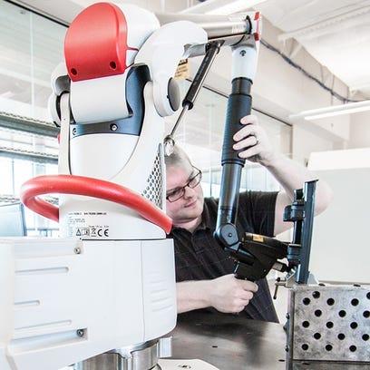 A laser-arm scanner — an example of robotics technology
