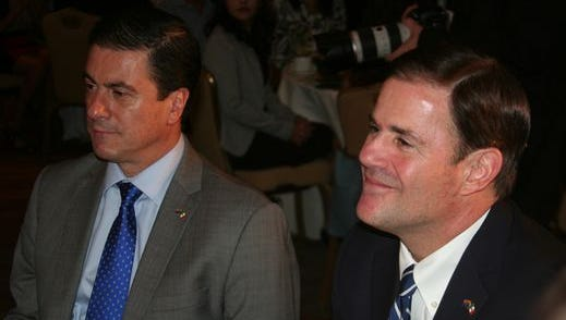 Arizona Gov. Doug Ducey (right) sits with Mexican Ambassador Gerónimo Gutiérrez Fernández at a recent event in Phoenix.