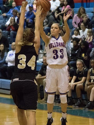 Sarah Abney (33) and the Las Cruces Bulldawgs face El Paso Coronado Tuesday to open the Holiday Hoopla Tournament.
