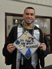Hector Diaz, Lebanon, a business major with a global studies minor, holds his decorated cap prior to commencement exercises at Lebanon Valley College on May 14, 2016.