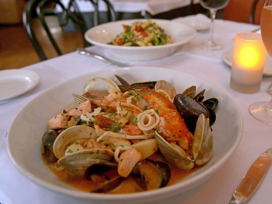 Zuppe di Pesce is clams, mussels, shrimp, calamari, scallops and chopped salmon over fettucine in lobster sauce and Pasta Portofino, penne with chicken, broccoli rate, roasted peppers, cannelloni beans in garlic and olive oil is served at Cafe Portofino in Piermont.