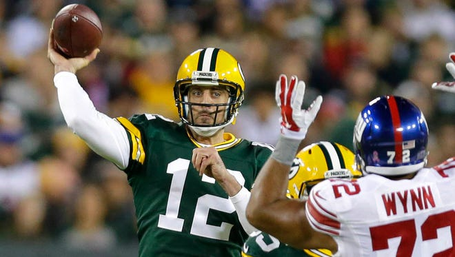 Green Bay Packers quarterback Aaron Rodgers looks for an open receiver against the New York Giants at Lambeau Field.