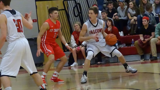 Fairfield Union's Brad Miller dribbles the ball against St. Charles Tuesday night. The Falcons had their nine-game winning streak snapped.