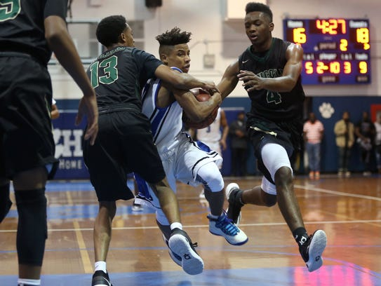 Godby's Tavaris King tries to drive between Lincoln's
