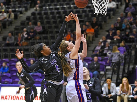 NSU's Cheyenne Brown defends against a Stephen F. Austin