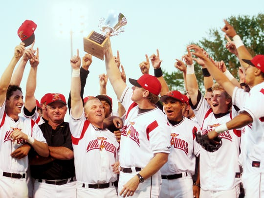 Former Volcanoes manager Steve Decker raises the trophy aloft as the Volcanoes celebrate one of the two Northwest League championships he skippered in 2006 and 2007.