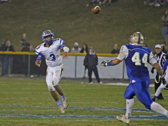 R.E. Lee's Jayden Williams throws a pass in the regional