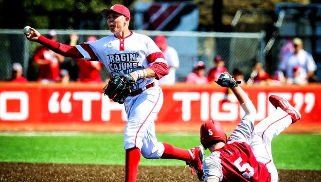 Cajuns shortstop Brad Antchak attempts to turn a double play during a series against Sacred Heart earlier this season.